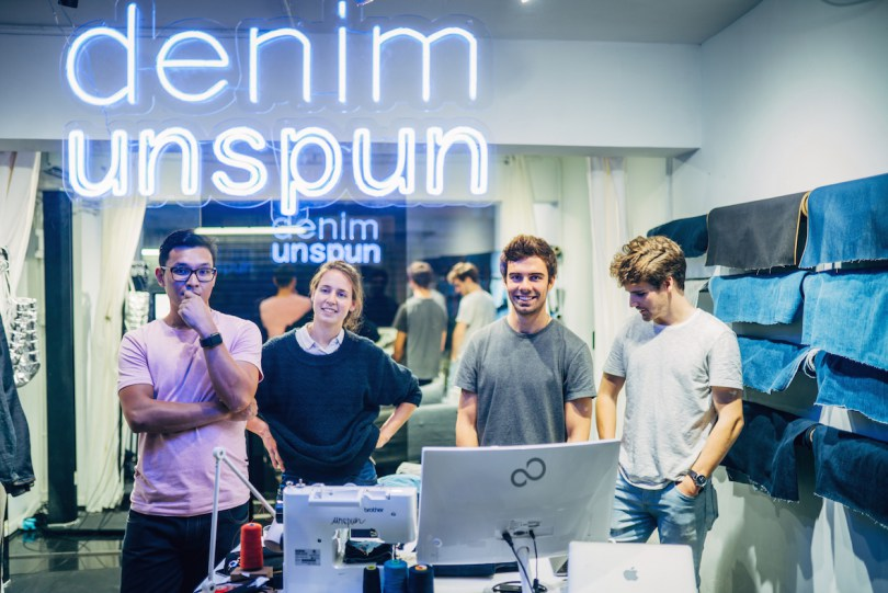 a unspum team prepare to sell jeans in pop-up store