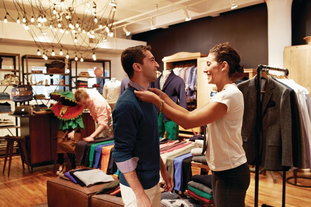 A customer and a personal stylist at the Bonobos menswear store