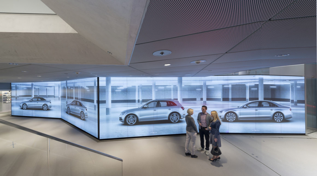 People at the Audi City wall displays